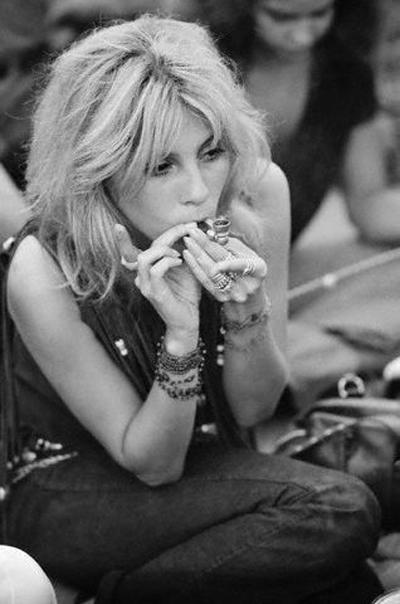 Woman Smoking Marijuana with a Pipe